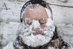 Local hunter washes his face with snow. To sustain good physical form and health (that is essential for a hunter) locals workout and ski.  Rubbing snow on face and body is very comon, especually after workouts and banya (Russian sauna)