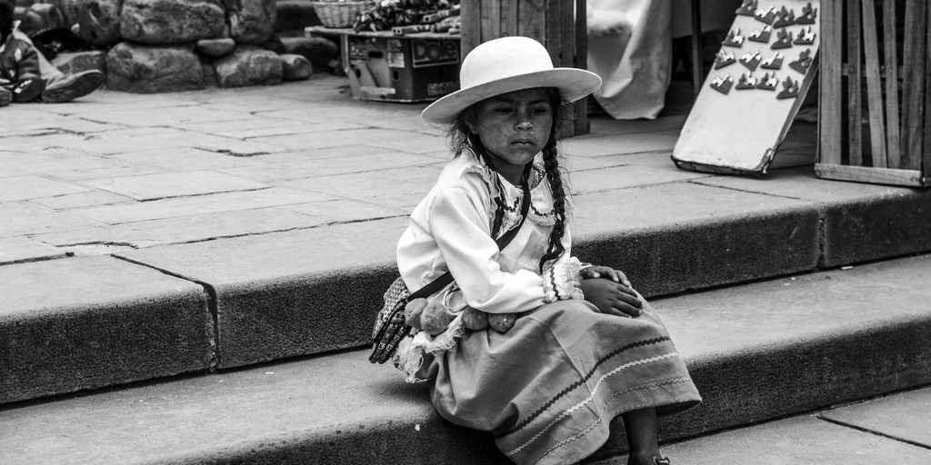 An Argentinean town situated right on the border with Bolivia, a little Indian girl sat in the market square. Like other residents, she was dressed in traditional folk costume. She stared into the distance thoughtfully, while her mother was selling a beautiful, hand-made doll.